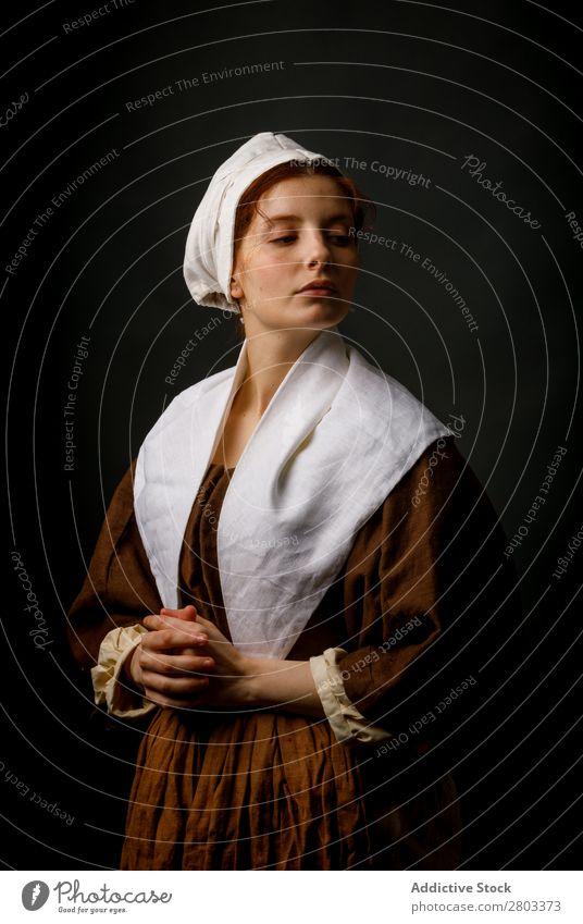 Medieval maid posing in studio medieval Woman Clothing historical Dress Costume maiden Car Hood Renaissance Vintage Retro peasant To enjoy Baroque Fantasy Hat