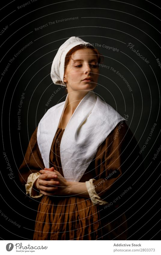 Medieval maid posing in studio Woman Clothing Dress Costume Car Hood Renaissance Vintage Retro
