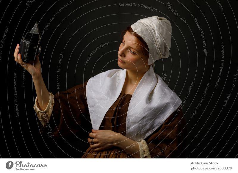 Medieval maid taking selfie Selfie Conceptual design Woman Clothing Dress Costume Car Hood Renaissance