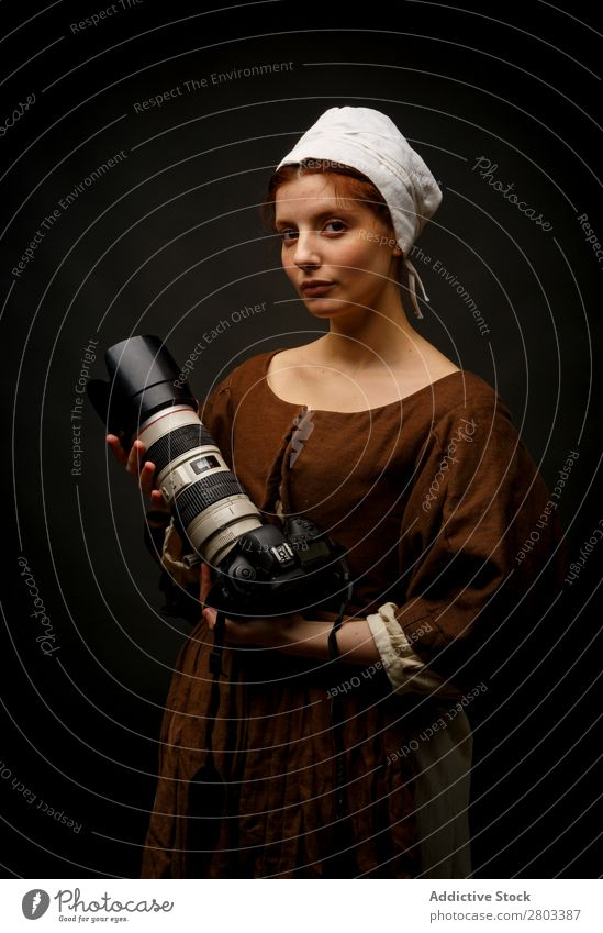 Medieval woman with photo camera Woman Red-haired Baroque Conceptual design Dress Carnival Renaissance Princess