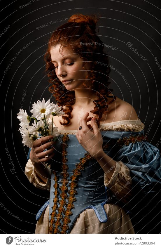 Baroque woman with closed eyes holding flowers Woman Flower daisies Red-haired Corkscrew Closed eyes Dress medieval Carnival Renaissance Princess Royal