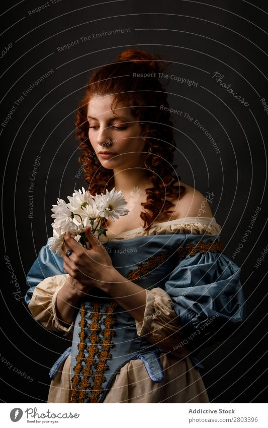 Baroque woman with closed eyes holding flowers Woman Flower Red-haired Corkscrew Dress Carnival Renaissance