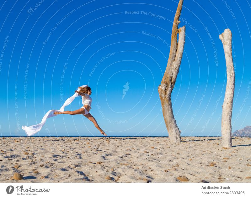 Woman jumping with pareo on beach Beach Rest Jump Summer Vacation & Travel Youth (Young adults) Relaxation Lifestyle Ocean Beautiful Trunk Blue sky