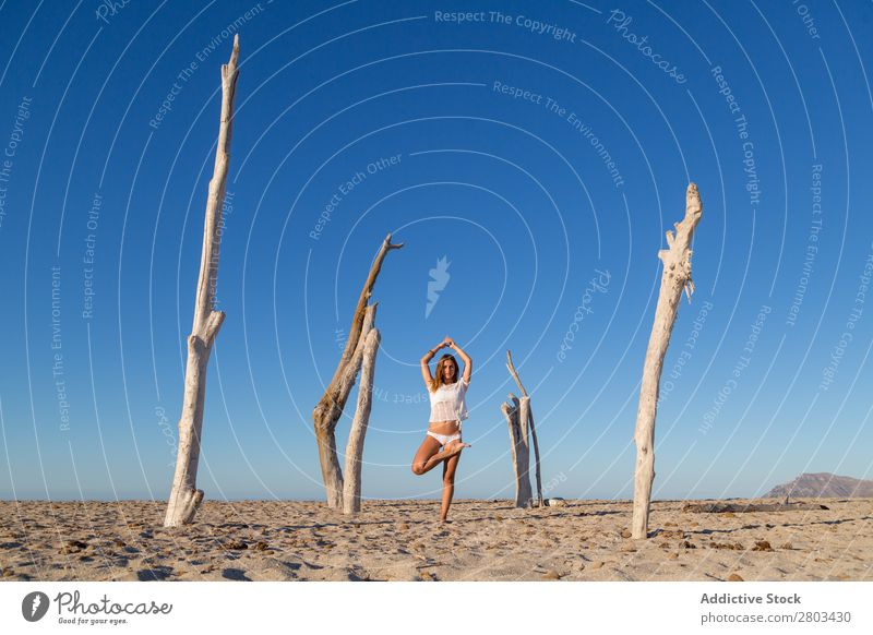 Woman doing yoga on beach Beach Yoga Rest Meditation Summer Vacation & Travel Youth (Young adults) Relaxation asana Peace Practice Balance Fitness Zen Calm