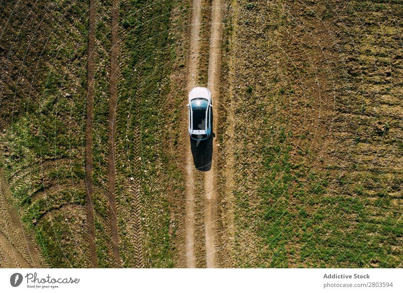 Aerial view of a car crossing a dirt road Vantage point Aircraft Street Car Landscape Vehicle Top Earth Drone Black Driving pov Countries Nature Field Transport