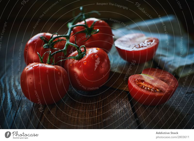 Fresh tomatoes on wooden table Tomato Table Wet Napkin bunch Healthy Red Food Vegetable Organic Mature Ingredients Vegan diet Half Cut whole Diet Raw Kitchen