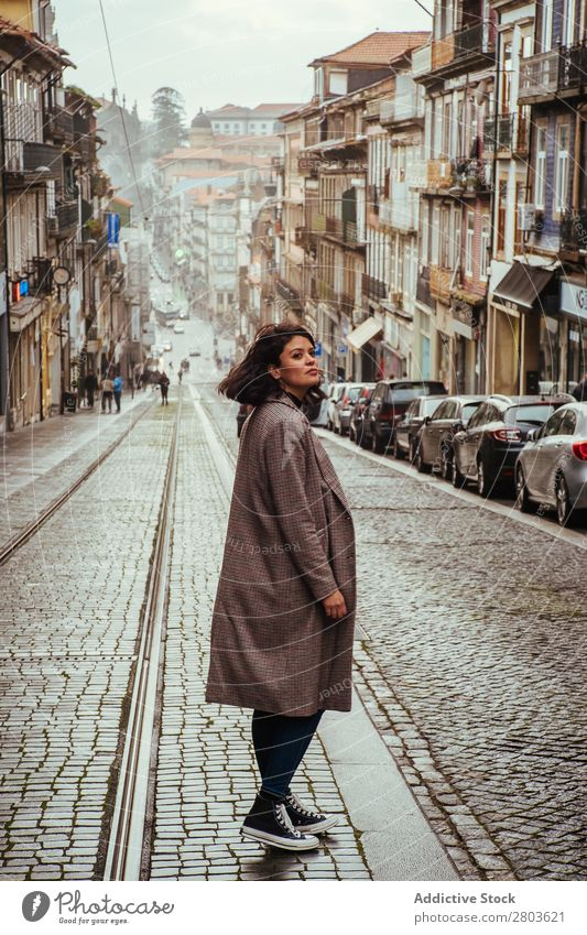 Trendy woman on old city street Woman City Old Street Looking away Tourism Porto