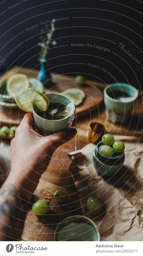 Arrangement of ceramic utensil on wood table Table Bunch of grapes Design Rustic Fresh Lemon Artisan Fruit