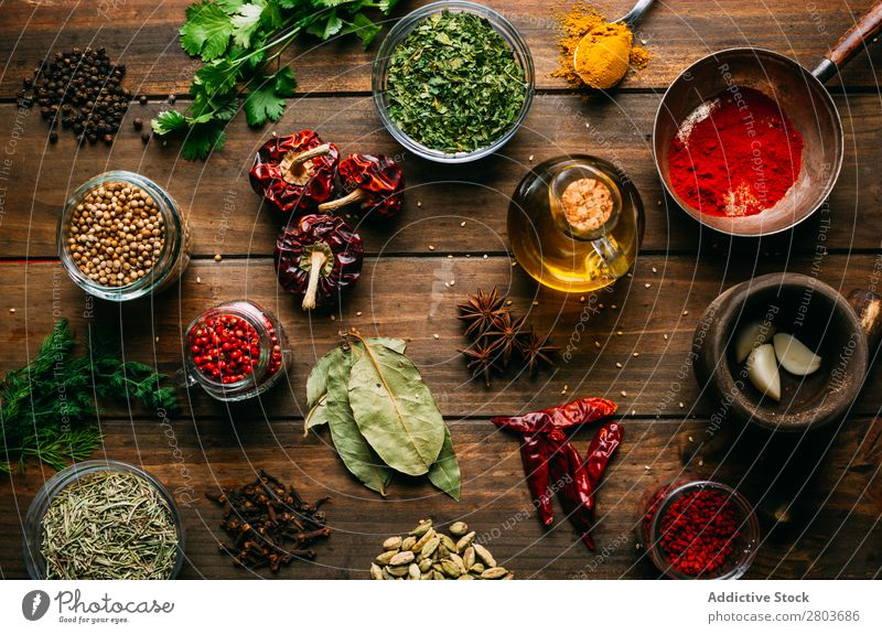 Spices and oil on table Herbs and spices Oil Table assortment Cooking Ingredients Set Fresh Dill Parsley Garlic anise turmeric Cardamom Coriander Chili
