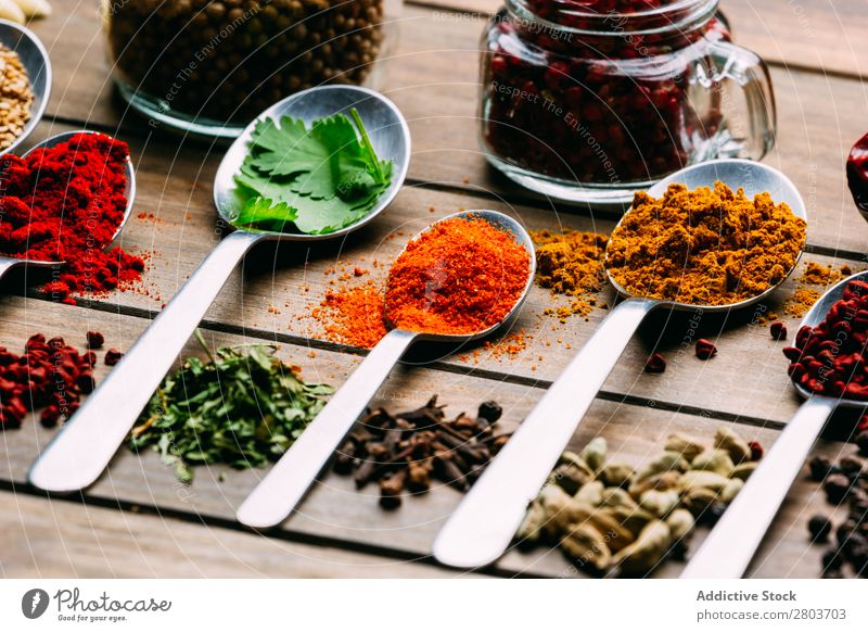 Set of various spices on table Herbs and spices Table assortment Oil Cooking Ingredients Fresh Dill Parsley Garlic anise turmeric Cardamom Coriander Chili