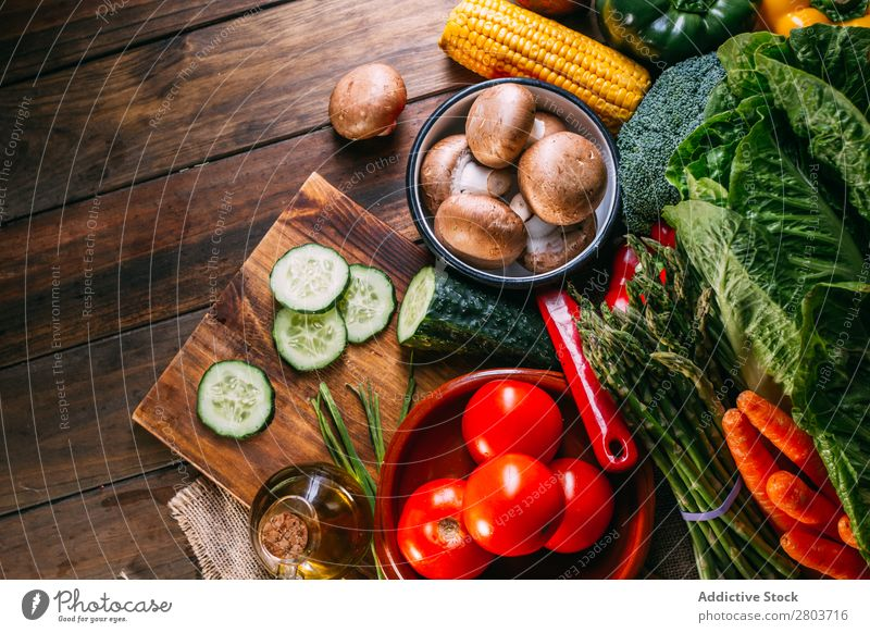 Vegetables and utensils on kitchen table Fresh Vitamin flat lay Oil composition Vertical corn Onion Ingredients Knives Pepper Bird's-eye view Food Cucumber Diet