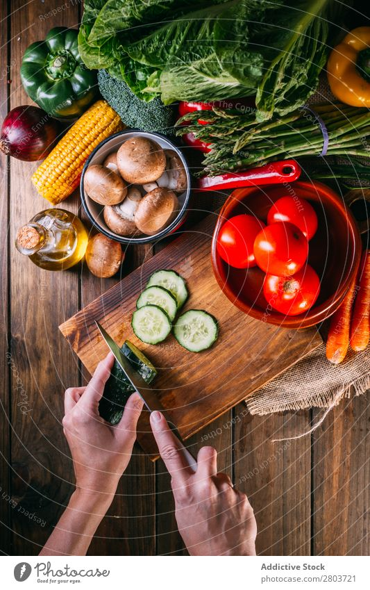 Vegetables and utensils on kitchen table Fresh Vitamin flat lay Oil composition Vertical corn Onion Ingredients Knives Pepper Bird's-eye view Food Cooking Table