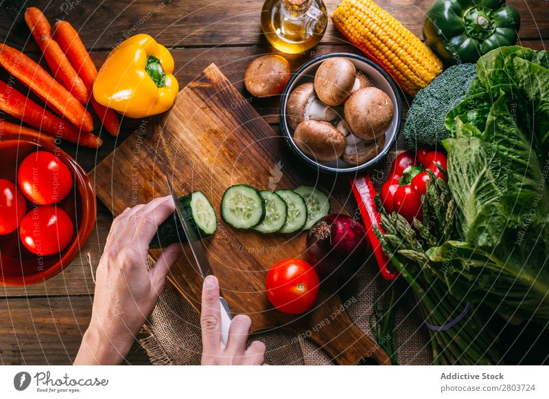 Vegetables and utensils on kitchen table Fresh Vitamin flat lay Oil composition corn Onion Ingredients Knives Pepper Bird's-eye view Food Cooking Table Wood