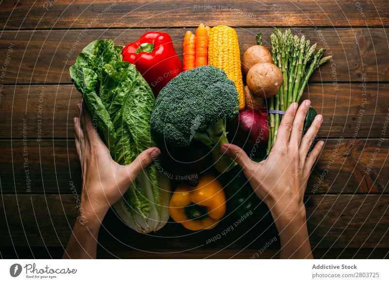 Vegetables and utensils on kitchen table Cooking Table Linen assortment Fresh Food Healthy Organic Vegan diet Kitchen Lettuce Broccoli Pepper Cucumber corn
