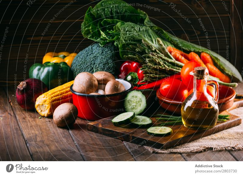 Vegetables and utensils on kitchen table Cooking Table Linen assortment Fresh Food Healthy Organic Vegan diet Knives Chopping board Kitchen Lettuce Broccoli