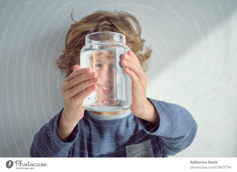 Boy holding vase with water near face Boy (child) Vase Water Smiling Clean Transparent Home Wall (building) White Face Easygoing Child Purity Clear Fresh