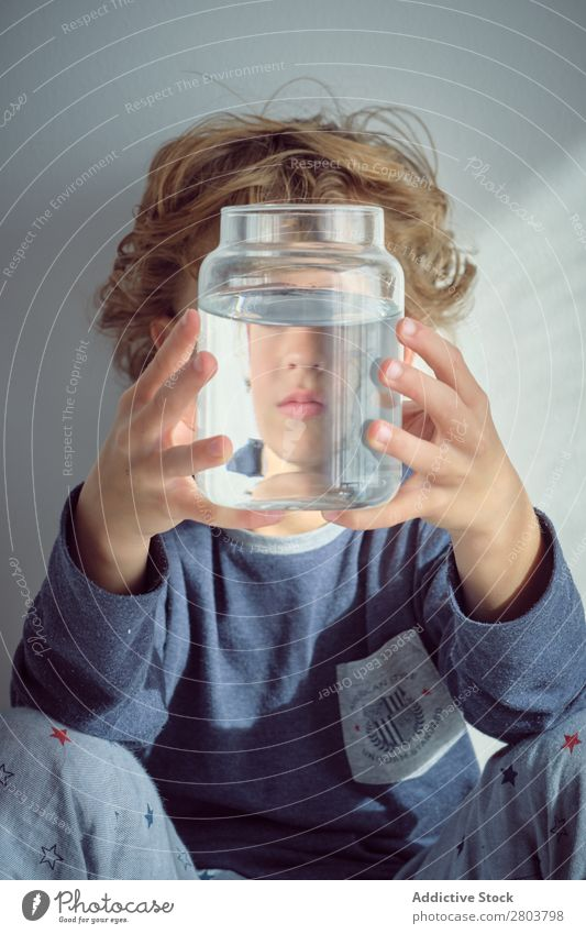 Boy holding vase with water near face Boy (child) Vase Water Clean Transparent Home Wall (building) White Face Easygoing Child Purity Clear Fresh Joy Cute
