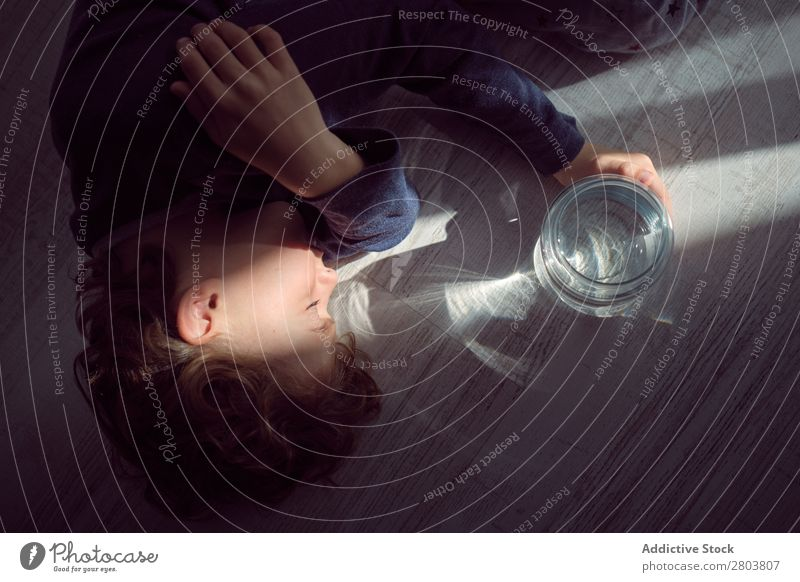 Boy sleeping on floor near jar of water Boy (child) Sleep Story Vase Water Clean Closed eyes Conceptual design Transparent Home Easygoing Child asleep Purity