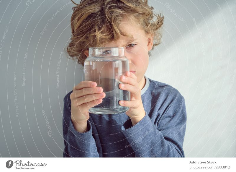 Boy holding vase with water near face Boy (child) Vase Water Clean Transparent Home Wall (building) White Face Easygoing Child Purity Clear Fresh Cheerful Joy