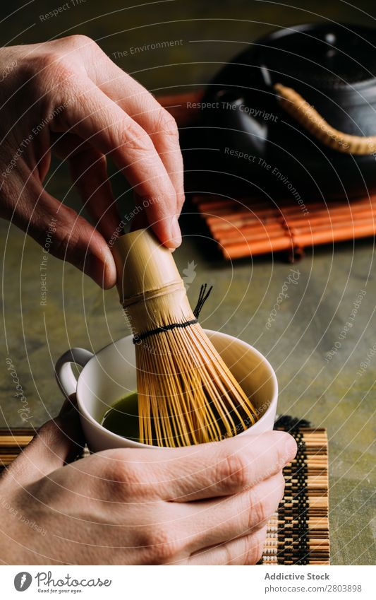 Preparing matcha tea Powder Wood Hand Herbs and spices Man Cup Drinking Tea Beater Scoop Japanese Teapot assorted Green Healthy Beverage Dark Water brew Bamboo