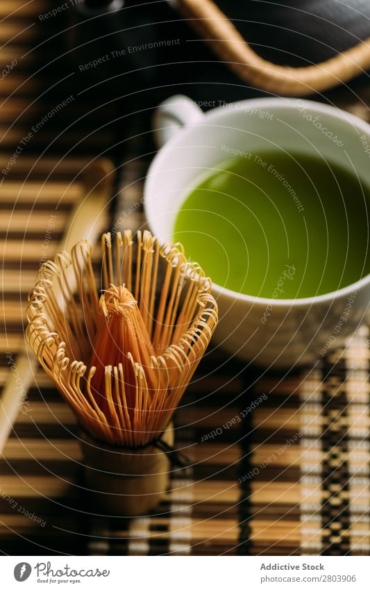 Preparing matcha tea assorted Bamboo Beverage brew Cup Dark Drinking Green Healthy Herbs and spices Japanese Powder Scoop Spoon Tea Teapot Water Beater Wood