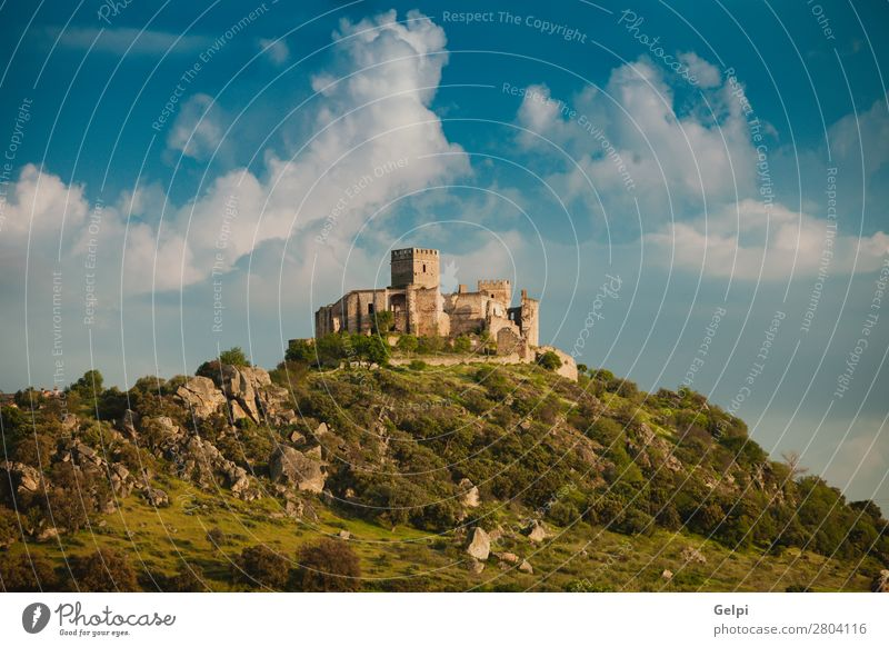 Beautiful Spanish old castle over a hill and a beautiful sky Vacation & Travel Tourism Mountain Landscape Sky Clouds Hill Rock Palace Castle Ruin Building