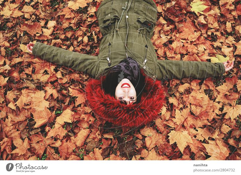Young woman lying down in the floor full of autumn leaves Face Calm Leisure and hobbies Human being Feminine Woman Adults Youth (Young adults) 1 18 - 30 years