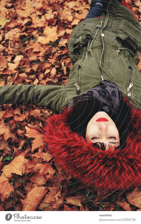 Young woman lying down in the floor full of autumn leaves Lifestyle Style Face Calm Leisure and hobbies Human being Feminine Woman Adults Youth (Young adults) 1