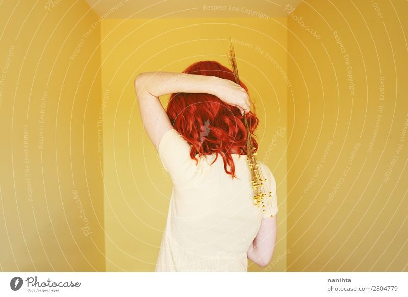 Young redhead woman with a yellow dress in a yellow room Lifestyle Elegant Style Beautiful Hair and hairstyles Calm Human being Feminine Young woman
