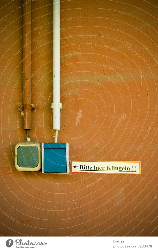 Bell? Technology Wall (barrier) Wall (building) Facade Switch Cable Signs and labeling Signage Warning sign Authentic Original Blue Brown Town