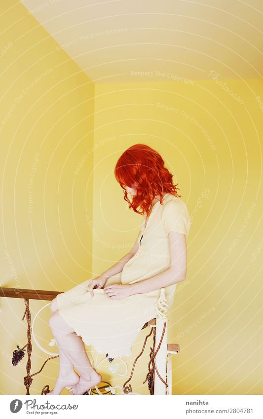 Young redhead woman with a yellow dress in a yellow room Lifestyle Style Beautiful Hair and hairstyles Calm Human being Feminine Young woman