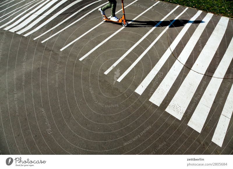 scooter Asphalt Driving Spring Light Child Playground Signs and labeling Scooter Roll Movement Shadow Summer Playing Stripe Line Copy Space