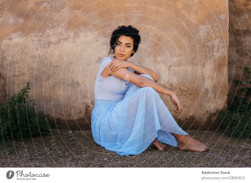 Beautiful ethnic woman near shabby wall Woman Moroccan Wall (building) grungy Ethnic Elegant Lean Exterior Building Youth (Young adults) Model Thin Shabby Dirty