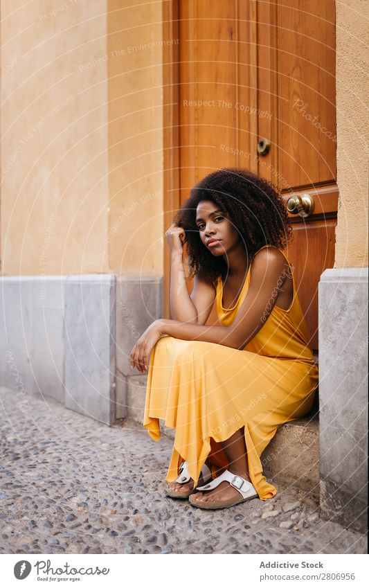 Gorgeous black woman in dress on street Woman Door Black Dress Curly Town To enjoy Barefoot Ethnic African-American Afro Beautiful tender Body Self-confident