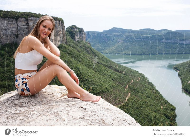 Woman sitting on stone at edge Sit Cliff The morro de l'abella Tavertet Vacation & Travel Landscape Height Nature Rock Beautiful Summer Happy Tourism Sunlight