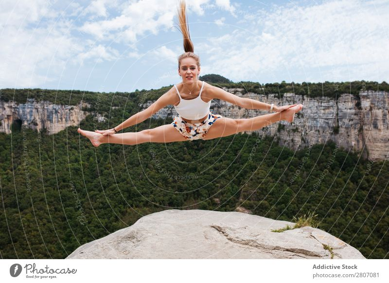 Woman jumping on cliff Jump Cliff Edge String Happy The morro de l'abella Tavertet Rock Youth (Young adults) Nature Summer Lifestyle Height Fly Human being Joy