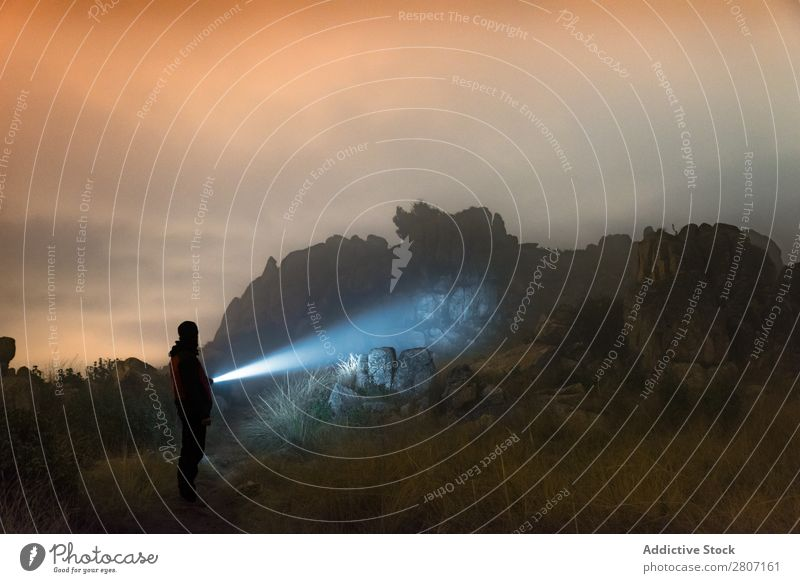 Man with flashlight at night in the mountains Adventure explore Mountain Lifestyle Loneliness Lantern Fog Flashlight Forest Nature Black Landscape Dawn Dark