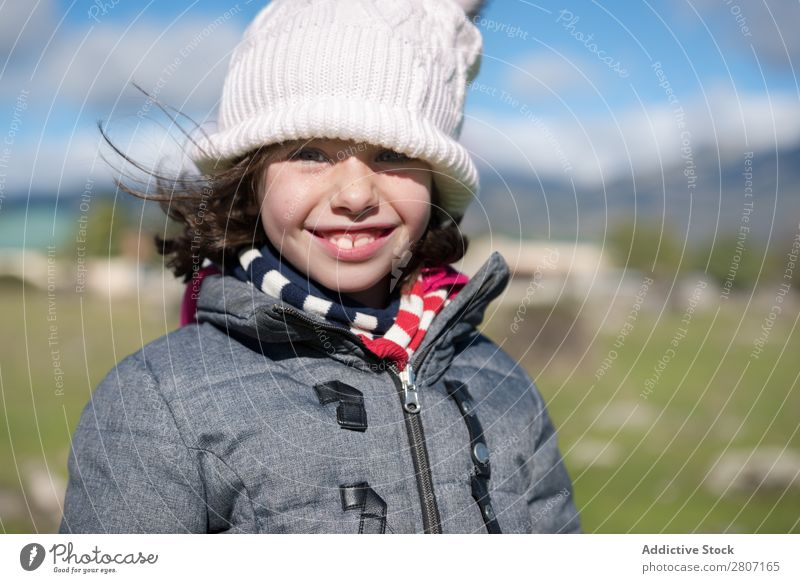Close-up of a little girl with wool cap and scarf in the field Girl Small Child Portrait photograph Background picture Wool Beautiful Exterior shot Field Hat