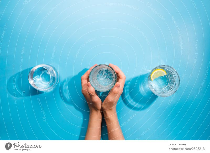 Woman's hands holding a cup of clean sparkling water Fresh Clean Bottle Object photography Beverage Cold Summer Cup Mug jar Difference Glass Caucasian White