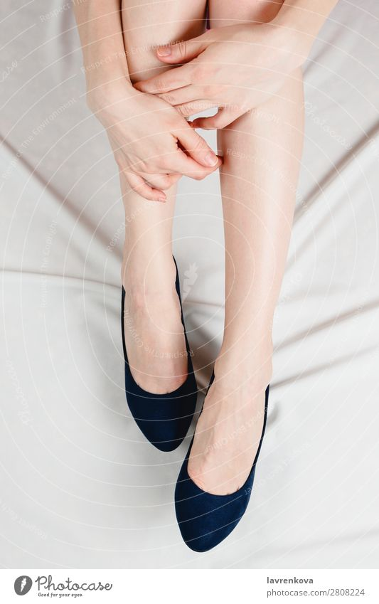 Above shot of white woman holding her legs in shoes Body Faceless Ankle High heels Hand Fashion Footwear Feet Human being Adults Legs Skin Young woman White