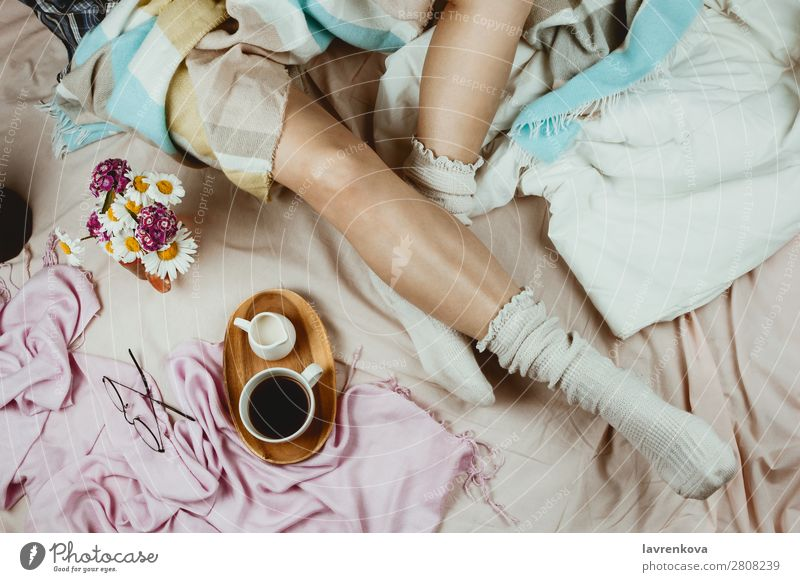White tanned woman in white socks sitting in her bed Cozy Winter Autumn flat lay hygge Adults Loneliness Beautiful Bed Bedclothes Blanket Duvet care Coffee