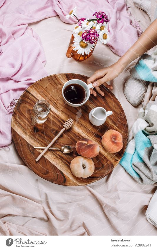 Cozy flatlay of wooden tray with cup of coffee, peaches, creamer Cup Mug flat lay Bedroom Breakfast Espresso Syrup Spoon Fruit Peach Bouquet Winter Autumn Woman