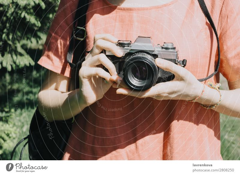 Portrait of young adult woman with vintage film camera outdoors Summer Tree Caucasian White pretty Photographer Hat Woman City Park Tourist Vacation & Travel