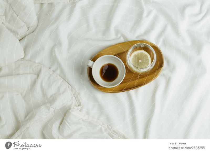 Cup of coffee and lemon water on wooden tray in bed Wood Tray Bedroom Espresso Healthy Healthy Eating holiday Tea Beverage Black Hot Morning Home