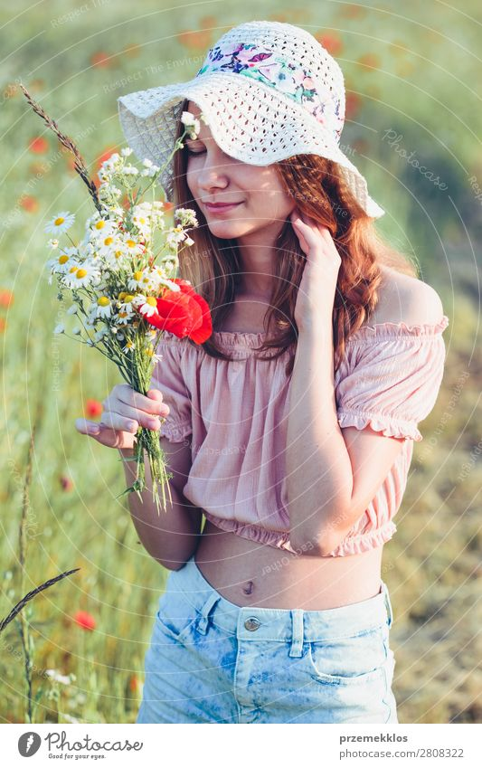 Beautieful young girl in the field of wild flowers Lifestyle Joy Happy Beautiful Summer Garden Child Human being Woman Adults Parents Mother Family & Relations