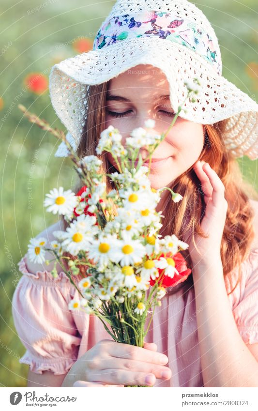 Beautieful young girl in the field of wild flowers Woman Child Human being Nature Youth (Young adults) Summer Plant Colour Beautiful Green White Flower Joy