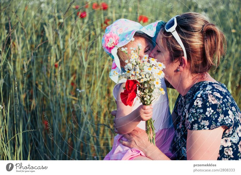 Mother and her little daughter in the field of wild flowers Woman Child Human being Nature Summer Plant Colour Beautiful Green White Flower Joy Lifestyle Adults