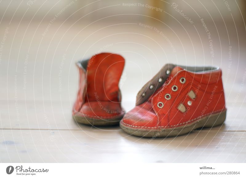 outgrown the child's shoes... Footwear Childrens shoe Leather Red White Nostalgia Small Eyelet Old Second-hand Childhood memory Childlike Colour photo