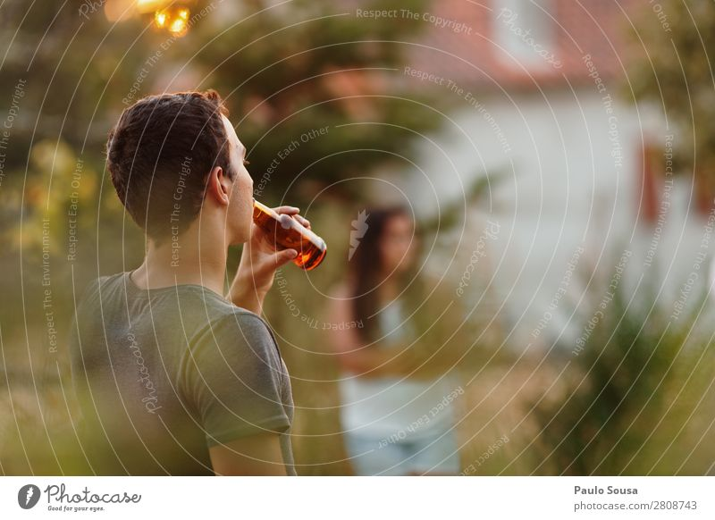 Drinking beer Beer Bottle Summer vacation Human being Masculine Young man Youth (Young adults) Friendship 1 18 - 30 years Adults Observe To enjoy Cool (slang)