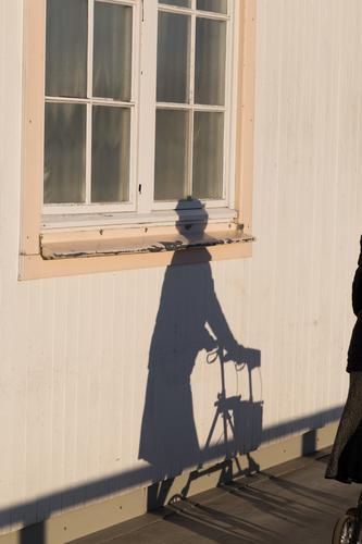 Shadow of a Lady with Rollator Human being Feminine Female senior Woman Senior citizen 1 Facade Window Pedestrian Movement Walking Old Illness Trust Walking aid